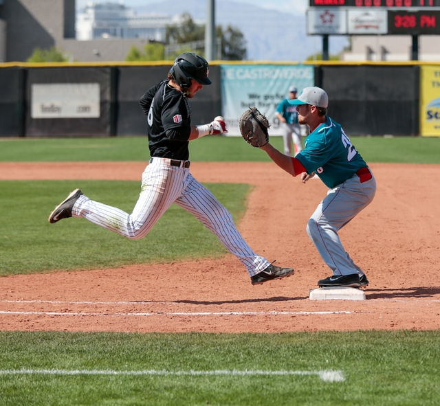 UNLV Rebels freshman Payton Squier (6) attempts to outrun the ball on his way to first base being covered by University of New Mexico sophomore Jack Zoellner (28)during a baseball game with the UN ...