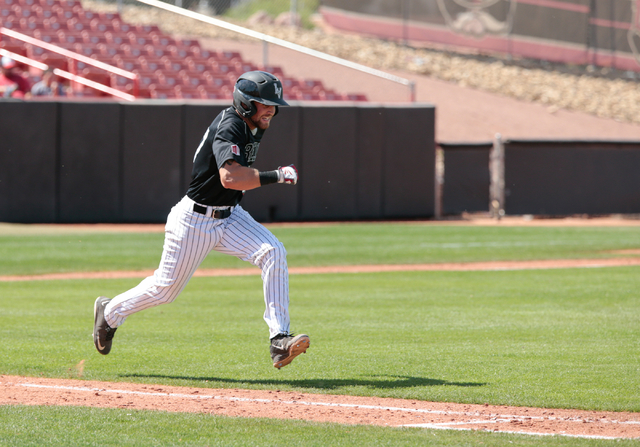 UNLV Rebels senior Dylan Ellis (37) runs for first base after making a hit during a baseball game with the UNLV Rebels against the University of New Mexico Lobos at Wilson Stadium on the UNLV camp ...