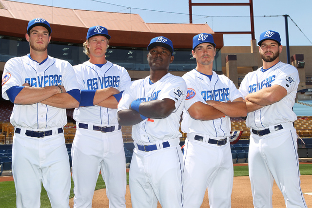 Las Vegas 51s players from left, Steven Matz (32), Noah Syndergaard (34), Dilson Herrera (2), Matt Reynolds (5), and Kevin Plawecki (23), pose for a photo on the field during media day at Cashman  ...