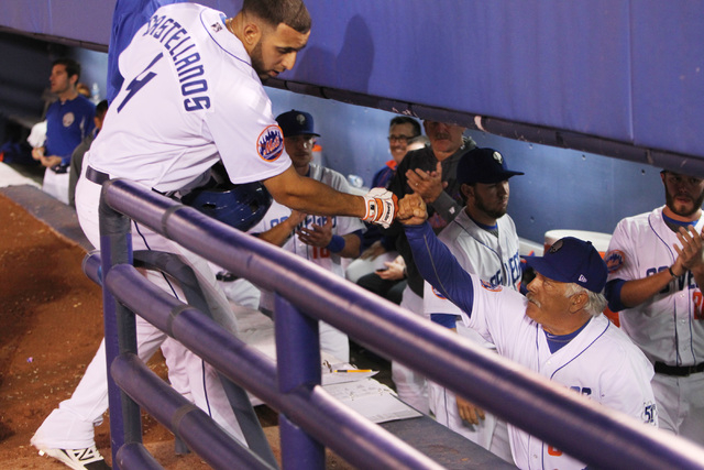 Las Vegas 51s Alex Castellanos is greeted by manager Wally Backman after Castellanos hit a two run homer against the Fresno Grizzlies during the 51s home opener Friday, April 17, 2015, at Cashman  ...