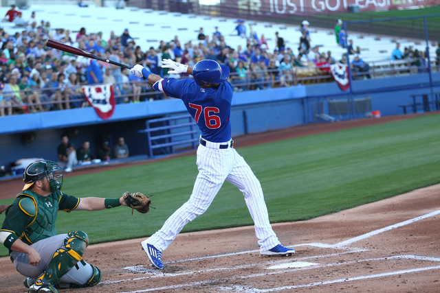 Kris Bryant of the Chicago Cubs swings at a pitchl against the Oakland Athletics during the Big League Weekend exhibition baseball game at Cashman Field in Las Vegas on Friday, March 13, 2015. (Ch ...