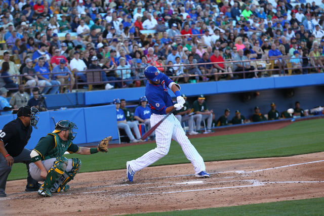 Kris Bryant of the Chicago Cubs swings at a pitch against the Oakland Athletics during the Big League Weekend exhibition baseball game at Cashman Field in Las Vegas on Friday, March 13, 2015. (Cha ...