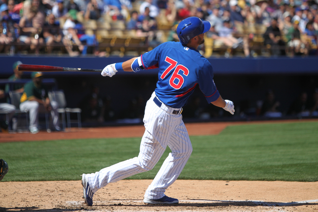 Kris Bryant (76) watches the ball fly to left field for a solo home run in the sixth inning against the Oakland Athletics in their Major League Baseball game at Cashman Field in Las Vegas Sunday,  ...