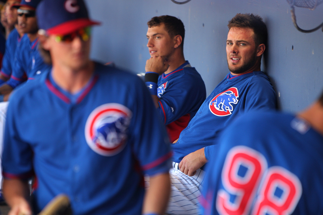 Kris Bryant (76), right, sits in the dugout after hitting a solo home run in the sixth inning against the Oakland Athletics in their Major League Baseball game at Cashman Field in Las Vegas Sunday ...