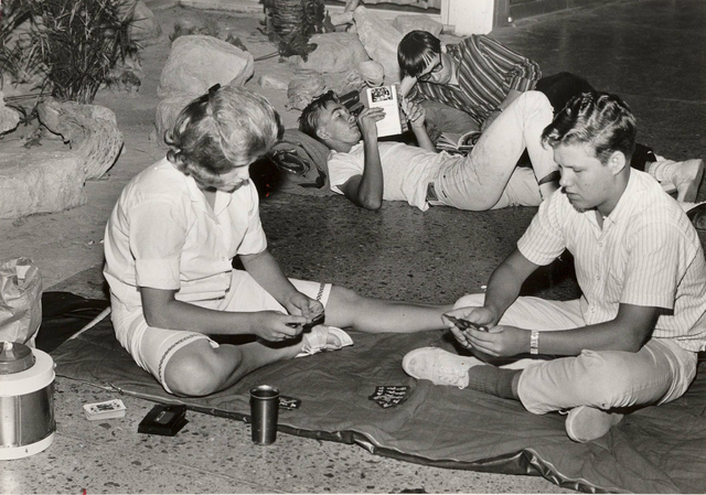 Beatles fans read and play cards to pass the time while while camping out overnight outside the Las Vegas Convention Center on June 29, 1964 to buy tickets for the Beatles concerts. (Terry Todd/La ...