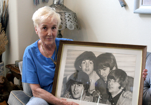 Barbara Eddowes holds a photo of The Beatles taken while she and her daughter, Sherri, were backstage after one of The Beatles' Las Vegas shows. They attended one of The Beatles' two Las Vegas ...