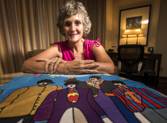 Christie Mullikin Jones, seen here with a T-shirt featuring the Beatles of a later era, saw the Beatles play Las Vegas on Aug. 20, 1964 and remains a lifelong fan. (Jeff Scheid/Las Vegas Review-Jo ...
