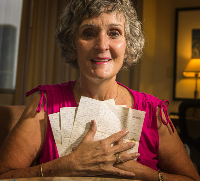Christie Mullikin Jones holds three letters that she wrote to her friend 50 years ago when her family came to Las Vegas to see the Beatles play at the Las Vegas Convention Center. (Jeff Scheid/Las ...