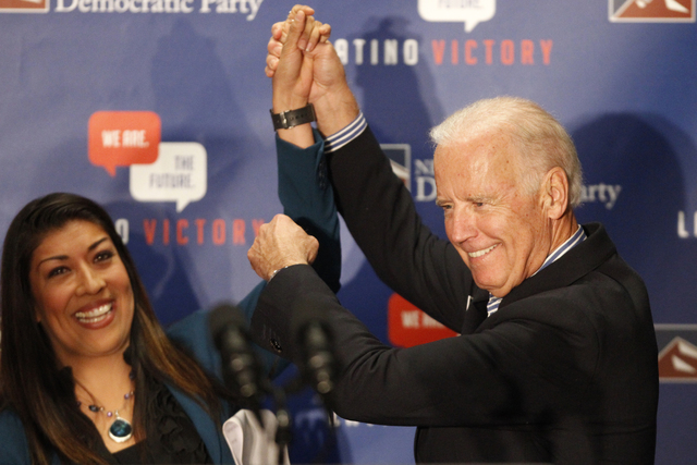 Lucy Flores and Vice President Joe Biden rally supporters during a get-out-the-vote event at the union hall for the Plumbers and Pipefitters Joint UA Local 525 in Las Vegas Saturday, Nov. 1, 2014. ...