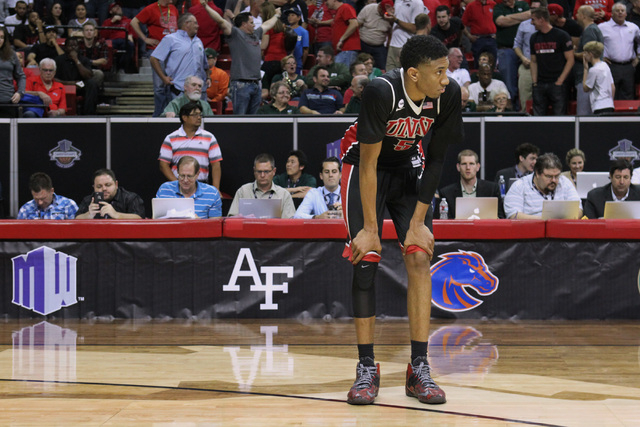 UNLV forward Christian Wood stands alone and watches San Diego State celebrate after their Mountain West Conference tournament quarterfinal game Thursday, March 12, 2015, at the Thomas & Mack Cent ...