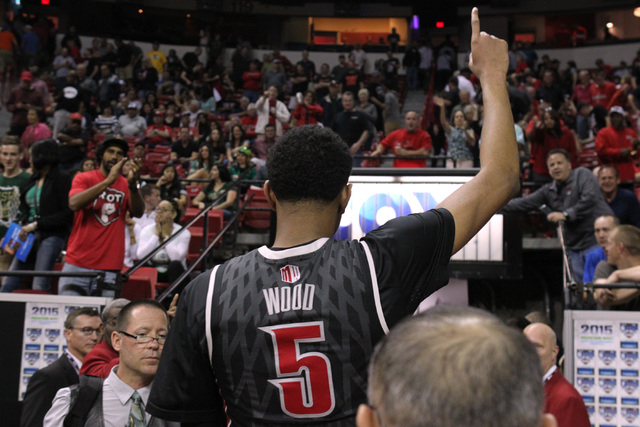UNLV forward Christian Wood salutes fans as he heads to the locker room after their Mountain West Conference tournament quarterfinal game against San Diego State Thursday, March 12, 2015, at the T ...