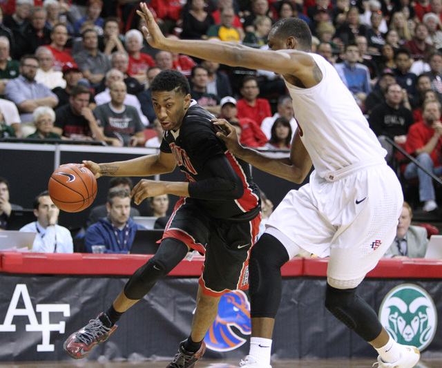 UNLV forward Christian Wood is guarded by San Diego State forward Skylar Spencer as he drives to the basket during the second half of their Mountain West Conference tournament quarterfinal game Th ...