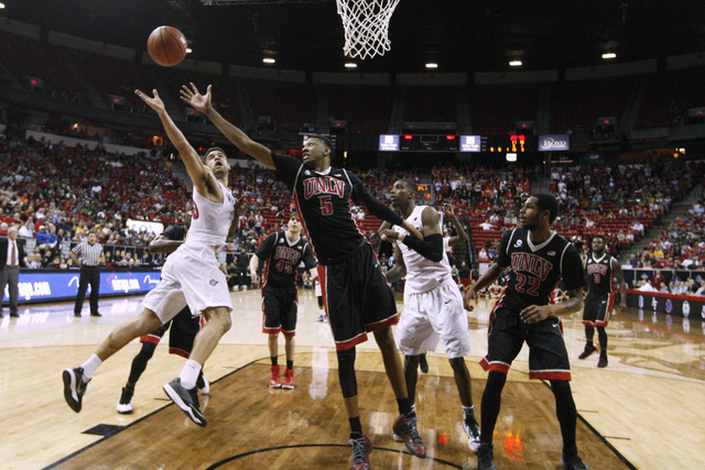 UNLV forward Christian Wood defends San Diego State forward J.J. O'Brien during the second half of their Mountain West Conference tournament quarterfinal game Thursday, March 12, 2015, at the Thom ...