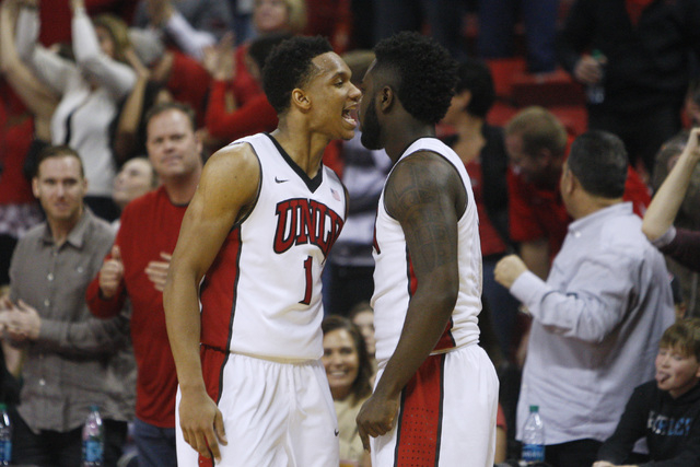UNLV guards Rashad Vaughn and Jordan Cornish celebrate the game tying basket against Utah State to force overtime in their Mountain West Conference game Saturday, Jan. 24, 2015, at the Thomas & Ma ...