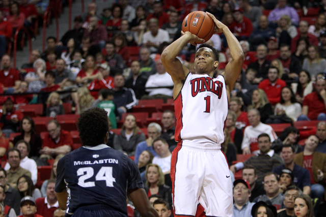 UNLV guard Rashad Vaughn takes a shot over Utah State forward Jojo McGlaston during the second half of their Mountain West Conference game Saturday, Jan. 24, 2015, at the Thomas & Mack Center. Vau ...