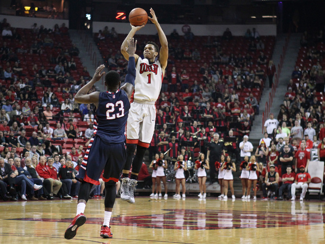 UNLV guard Rashad Vaughn takes a 3-point shot over Fresno State guard Marvelle Harris during the first half of their Mountain West Conference game Tuesday, Feb. 10, 2015, at the Thomas & Mack Cent ...