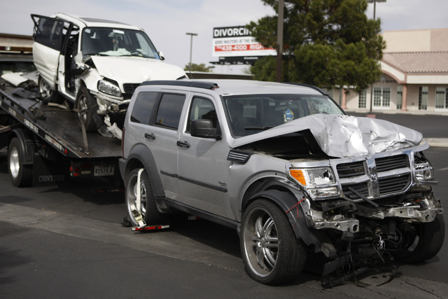 Two vehicles involved in a four vehicle car accident are seen at the scene of the accident at the intersection of Bonanza Road and Pecos Road in Las Vegas Sunday, April 5, 2015. (Erik Verduzco/Las ...