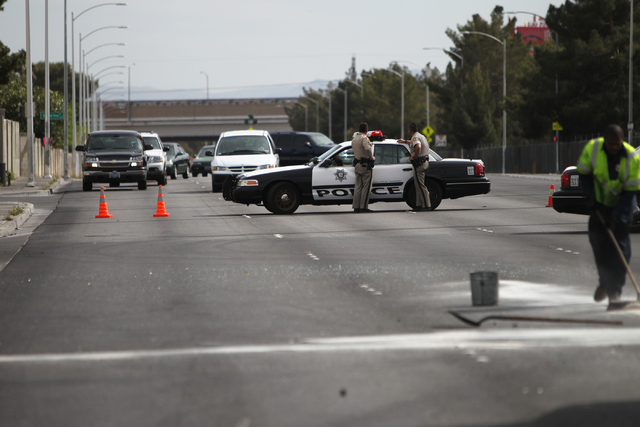 Las Vegas police officers divert traffic at the scene of a four vehicle car accident at the intersection of Bonanza Road and Pecos Road in Las Vegas Sunday, April 5, 2015. (Erik Verduzco/Las Vegas ...