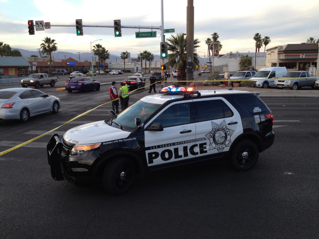 Las Vegas police block both lanes of Bonanza Road east of Las Vegas Boulevard as investigators continue to look at the scene of an accident earlier on Thursday, April 30, 2015. (Greg Haas/Las Vega ...