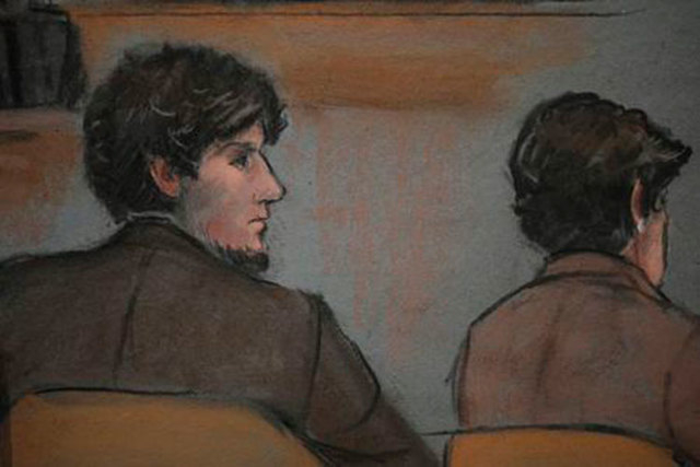 A courtroom sketch shows accused Boston Marathon bomber Dzhokhar Tsarnaev, left, in court at the federal courthouse in Boston, March 5, 2015. (Reuters/Jane Flavell Collins)
