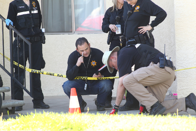 Las Vegas and Boulder City police investigate the scene of an officer-involved shooting at Fifth Street and Avenue A in Boulder City on March 30, 2015. (Chase Stevens/Las Vegas Review-Journal)