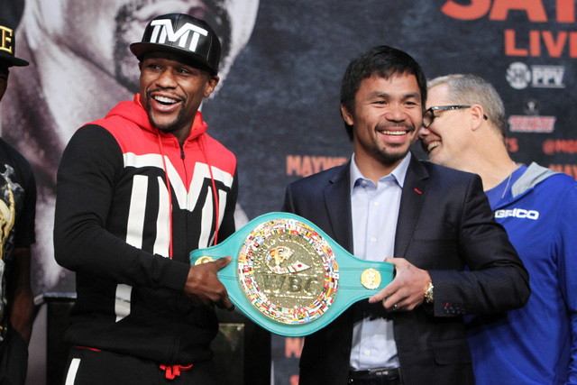 Floyd Mayweather Jr., left, and Manny Pacquiao hold the WBC championship belt during their news conference Wednesday, April 29, 2015 at the MGM Grand. (Sam Morris/Las Vegas Review-Journal) Follow  ...