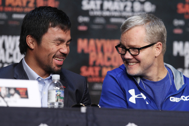 Manny Pacquiao and trainer Freddie Roach laugh during the final news conference for his fight against Floyd Mayweather Jr. Wednesday, April 29, 2015 in the Ka Theater at the MGM Grand. (Sam Morris ...