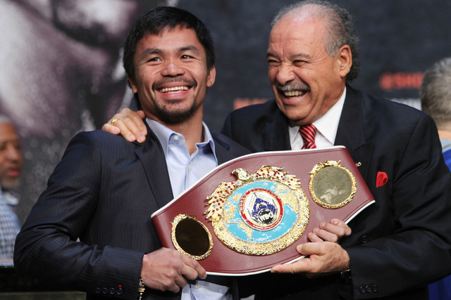 WBO champion Manny Pacquiao poses with WBO President Paco Valcarcel and his championship belt during the final news conference for his fight against Floyd Mayweather Jr. Wednesday, April 29, 2015  ...