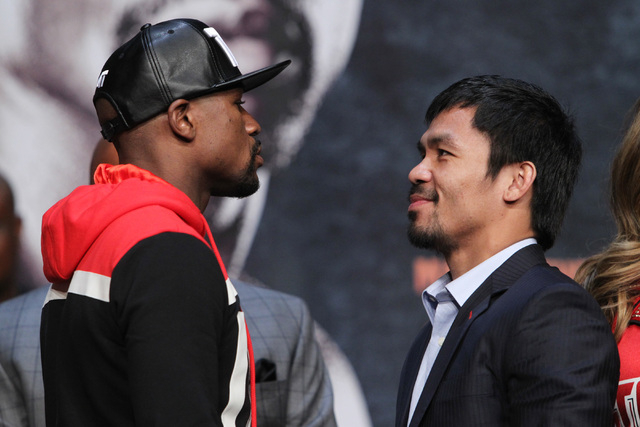 Floyd Mayweather Jr. and Manny Pacquiao face off during their news conference Wednesday, April 29, 2015 in the Ka Theater at the MGM Grand. (Sam Morris/Las Vegas Review-Journal) Follow Sam Morris  ...
