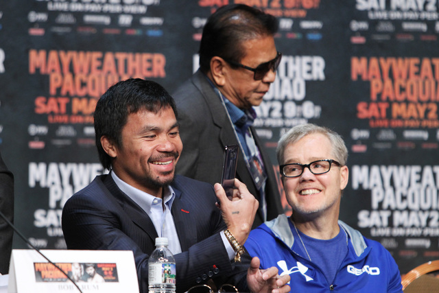Manny Pacquiao takes video of the scene during the final news conference for his fight against Floyd Mayweather Jr. Wednesday, April 29, 2015 in the Ka Theater at the MGM Grand. (Sam Morris/Las Ve ...