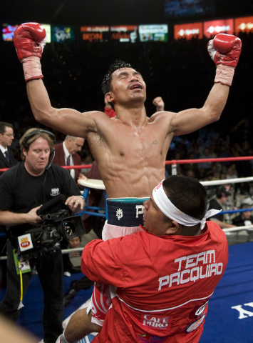 Manny Pacquiao of the Philippines celebrates his ninth round knockout victory over David Diaz of Chicago their WBC World Lightweight Championship boxing bout at Mandalay Bay Events Center Saturday ...