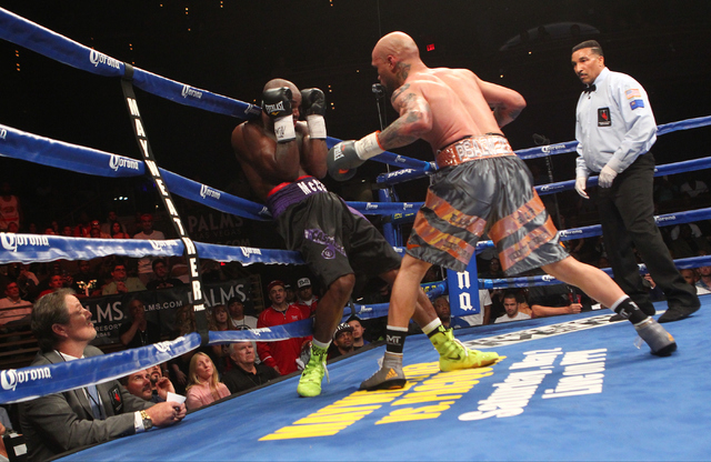 Ishe Smith, right, delivers punches to Cecil McCalla against the ropes during their junior middleweight fight at The Pearl at the Palms hotel-casino in Las Vegas on Thursday, April 30, 2015. Ishe  ...