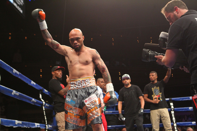 Ishe Smith acknowledges the crowd before fighting Cecil McCalla, not pictured, in their junior middleweight fight at The Pearl at the Palms hotel-casino in Las Vegas on Thursday, April 30, 2015. I ...