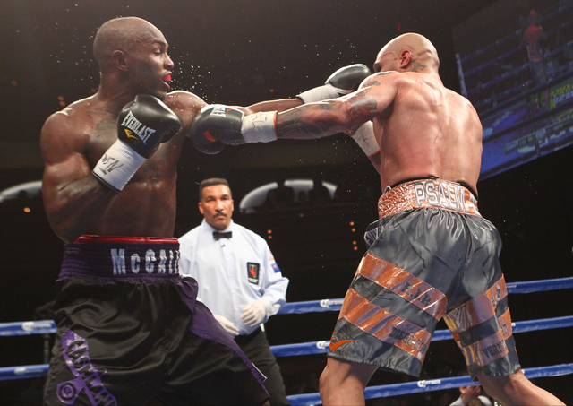 Cecil McCalla, left, and Ishe Smith exchange punches during their junior middleweight fight at The Pearl at the Palms hotel-casino in Las Vegas on Thursday, April 30, 2015. Ishe Smith won the figh ...