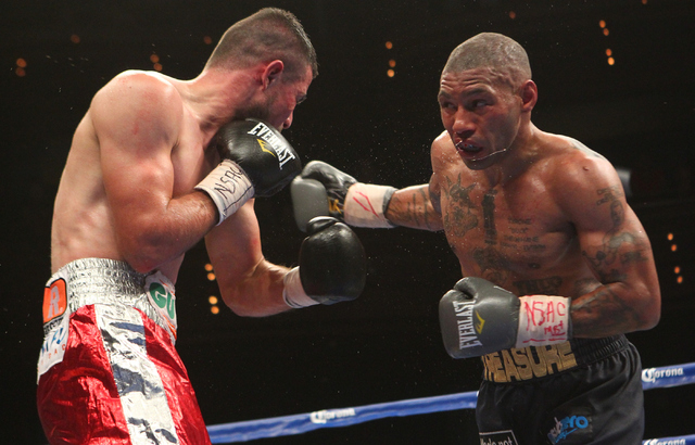 Ashley Theophane, right, looks to deliver a punch to Mahonri Montes during their junior welterweight fight at The Pearl at the Palms hotel-casino in Las Vegas on Thursday, April 30, 2015. Theophan ...