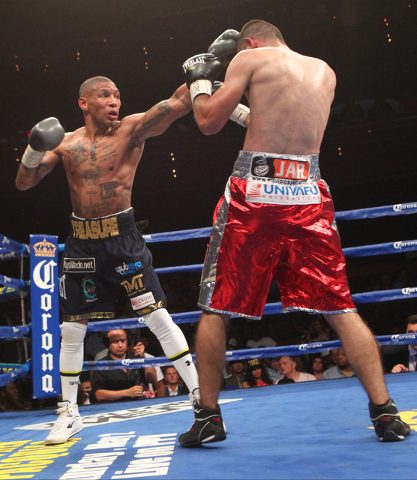 Ashley Theophane, left, connects with Mahonri Montes during their junior welterweight fight at The Pearl at the Palms hotel-casino in Las Vegas on Thursday, April 30, 2015. Theophane won the bout  ...