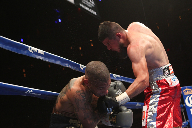 Mahonri Montes, right, connects with Ashley Theophane during their junior welterweight fight at The Pearl at the Palms hotel-casino in Las Vegas on Thursday, April 30, 2015. Theophane won the bout ...