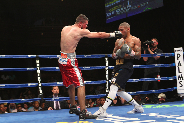 Mahonri Montes, left, connects with Ashley Theophane during their junior welterweight fight at The Pearl at the Palms hotel-casino in Las Vegas on Thursday, April 30, 2015. Theophane won the bout  ...