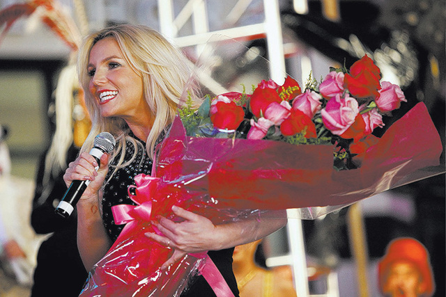 Britney Spears speaks to a crowd in front of Planet Hollywood in Las Vegas, Dec. 3, 2013 to promote her new show at the casino. Spears' camp announced on Thursday that her year-plus romance with ...