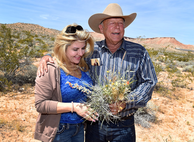 Nevada Assemblywoman Michele Fiore, left, accepts a bouquet of desert foliage from rancher Cliven Bundy during a news conference at an event near his ranch in Bunkerville on Saturday, April 11, 20 ...