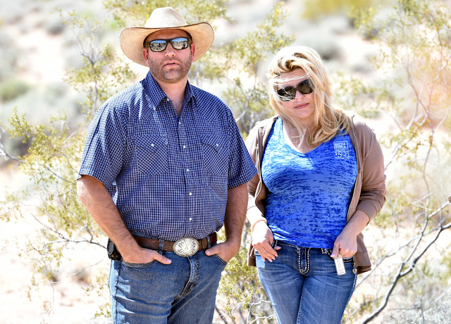 Cliven Bundy's son, Ammon Bundy, left and Nevada Assemblywoman Michele Fiore look on during a news conference at an event near the Bundy Ranch in Bunkerville on Saturday, April 11, 2015.  Cliven B ...