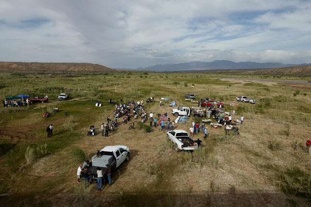 People gather along the Virgin River during a rally in support of Cliven Bundy near Bunkerville, Nev. Friday, April 18, 2014. (John Locher/Las Vegas Review-Journal)