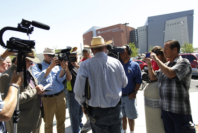 Ammon Bundy, son of rancher Cliven Bundy, talks to the media after filing official complaints and pressing charges against federal law enforcement agents stemming from last months failed cattle ro ...