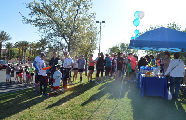 Runners register for the Friends of Parkinson's first Funny Bunny Race at Bruce Trent Park, 8851 Vegas Drive, April 4, 2015. The race had 270 participants. (Special to View) Click the image for an ...