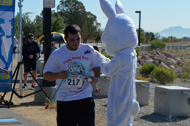 A runner finishes the 5K during the Friends of Parkinson's first Funny Bunny Race at Bruce Trent Park, April 4, 2015. The race had 270 participants.