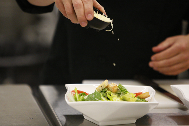 Rancho High School culinary instructor, Chef Phillip Dell, instructs his class on how to prepare a caesar salad at Rancho High School in North Las Vegas Wednesday, April 8, 2015. (Erik Verduzco/La ...