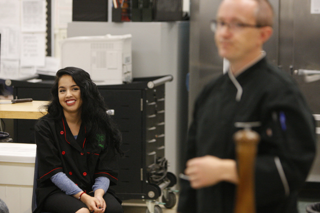 Student Esmeralda Lopez, 16, smiles as she listens to Rancho High School culinary instructor, Chef Phillip Dell, during his class at Rancho High School in North Las Vegas Wednesday, April 8, 2015. ...