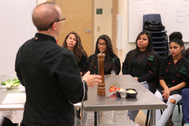 Rancho High School students from left, Sandra Roa, 16, Valerie Wren, 15, Mitzi Meza, and Janelle Meza, 15, listen to culinary instructor, Chef Phillip Dell, during his class at Rancho High School  ...