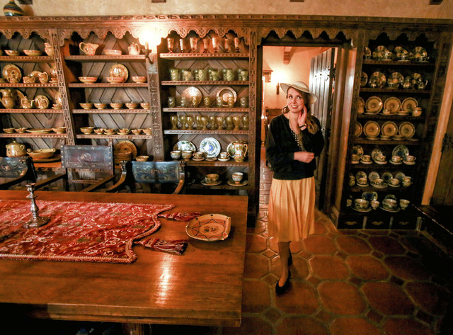 A U.S Forest Service tour guide dressed in period clothes stands in the dining room at Scotty's Castle in Death Valley National Park on Saturday March 9, 2013.  (Jeff Scheid/Las Vegas Review-Journal)