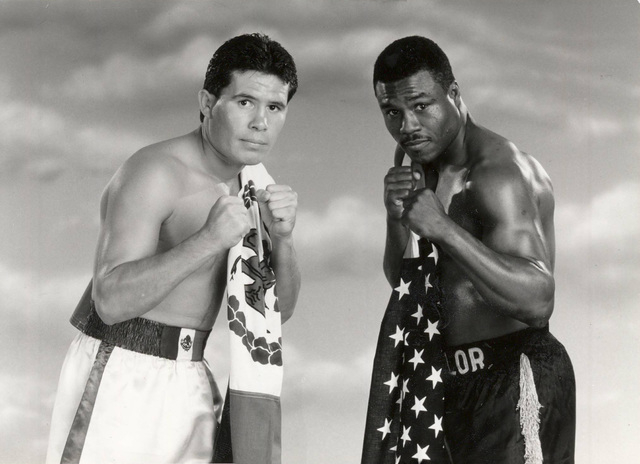 Boxer Julio Cesar Chavez, left, poses with his opponent Meldrick Taylor in this 1990 promotional photograph. The two fighters are scheduled to battle for WBC/IBF Junior Welterweight championship o ...